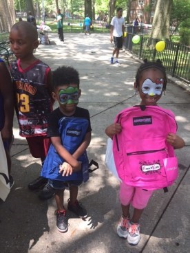 Children with donated backpacks