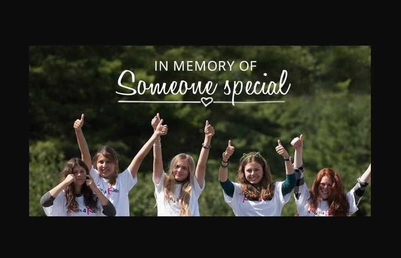 Girl Zoniac campers point to text: In memory of someone special sign