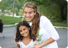 A female counselor smiles with her camper in TheZone summer camp