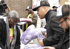 Cory Booker participates in a winter coat giveaway sponsored by Kars4Kids to benefit children in Newark